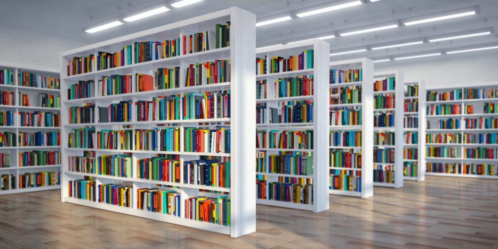 Library. Background from white bookshelves with books and textb