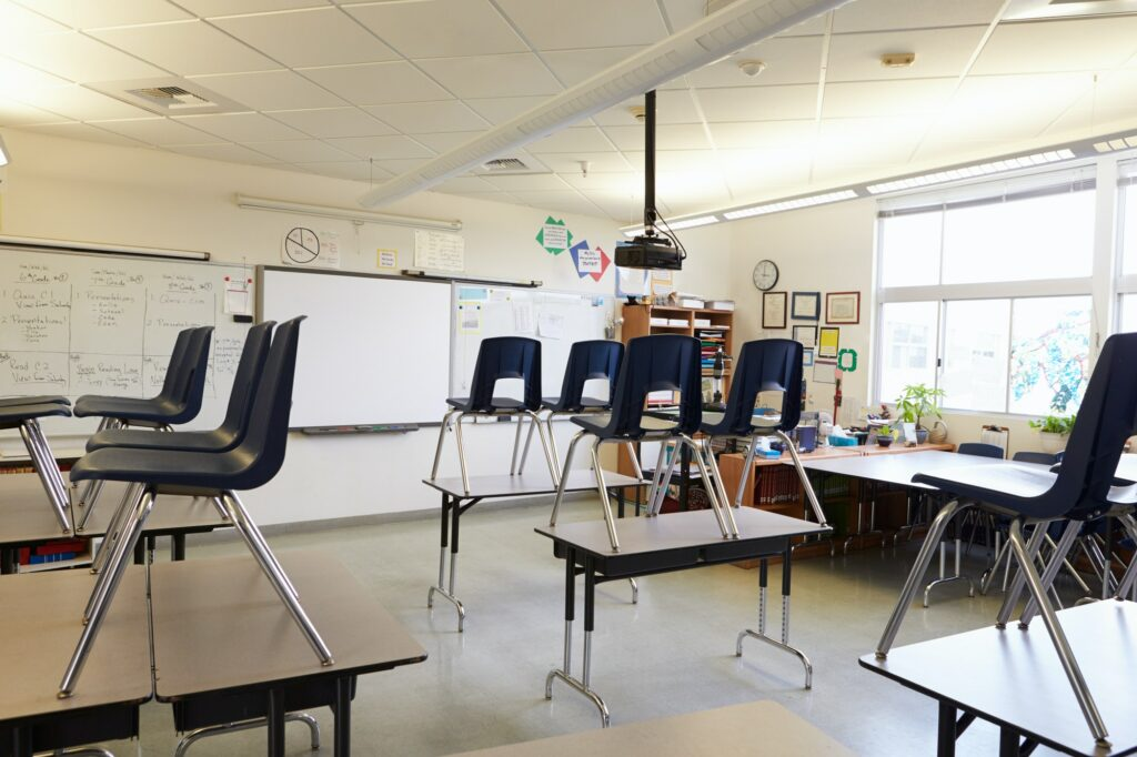 Empty classroom with chairs on tables